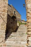 Beautiful old stone stairs in Spanish ancient village, Pals, in Costa Brava.  Stock Photo
