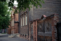 The beautiful old street in the city. The beautiful old street with old wooden and brick houses with a porch in the city Stock Image