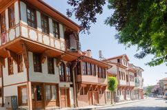 Beautiful old street in downtown with houses with wooden shutter. S in the classic Turkish Ottoman style, Turkey, center of Afyon The two-storyed buildings with Stock Photo