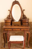 Beautiful old style carwed wooden table with mirror and chair Stock Image