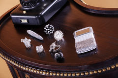 Beautiful old table with jewelery Stock Photography