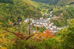Scenic view of Esch sur sure town in Luxembourg in fall season. Beautiful old town of Esch sur Sure hidden in the Ardennes forest on the Sure river bank Stock Photo