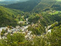 Scenic view of Esch sur sure town in Luxembourg in summer. Beautiful old town of Esch sur Sure hidden in the Ardennes forest on the Sure river bank meandering Stock Photo