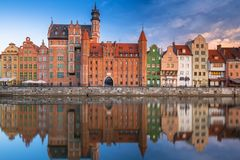 Beautiful old town of Gdansk reflected in Motlawa river. At sunrise, Poland Stock Photos