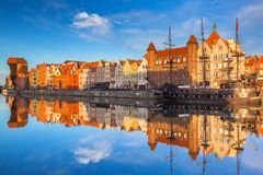Beautiful old town of Gdansk reflected in Motlawa river. At sunrise, Poland Royalty Free Stock Photo