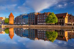 Beautiful old town of Gdansk reflected in Motlawa river. At sunrise, Poland Royalty Free Stock Image