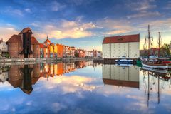 Beautiful old town of Gdansk reflected in Motlawa river. At sunrise, Poland Stock Images