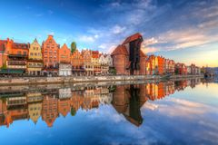 Beautiful old town of Gdansk reflected in Motlawa river. At sunrise, Poland Royalty Free Stock Photos