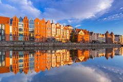 Beautiful old town of Gdansk reflected in Motlawa river. At sunrise, Poland Stock Photography