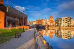 Beautiful old town of Gdansk reflected in Motlawa river. At sunrise, Poland Royalty Free Stock Images