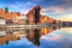 Old town of Gdansk at Motlawa river. Beautiful old town of Gdansk reflected in Motlawa river at sunrise, Poland Stock Photography