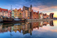 Old town of Gdansk at Motlawa river. Beautiful old town of Gdansk reflected in Motlawa river at sunrise, Poland Stock Photo