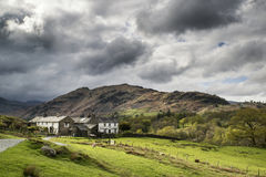 Beautiful old village landscape nestled in hills in Lake Distric Royalty Free Stock Photography