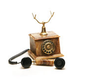 A beautiful old vintage brown telephone on white Royalty Free Stock Photo