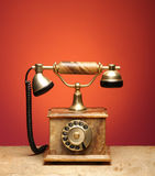 A beautiful old vintage telephone on a table royalty free stock image