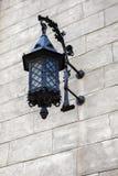 Beautiful old vintage wrought iron lantern. On a stone wall stock image