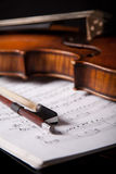 Beautiful old violin. On dark background Stock Photos