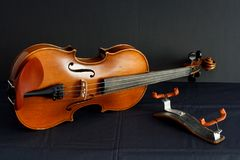 Beautiful old violin and bridge royalty free stock photography