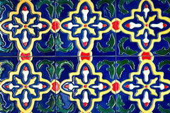Beautiful old wall ceramic tiles patterns handcraft from thailand public. Royalty Free Stock Photography