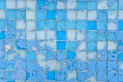 Beautiful old wall decorative, colorful small mosaic texture, shabby squares. Decorative colored tiles. Repair of interior and stock photo