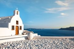 Beautiful old white church against the blue sky and blue Aegean sea. Oia, Santorini, Greece, Europe. Classic white Greek. Architecture, houses, churches. Travel stock images