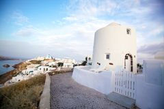 White architecture on Santorini island, Greece. Beautiful old white ortodox church in sunny day with blue sky in Oia on Santorini island. Santorini is romantic Royalty Free Stock Photos