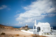 White architecture on Santorini island, Greece. Beautiful old white ortodox church in sunny day with blue sky in Oia on Santorini island. Santorini is romantic Stock Image