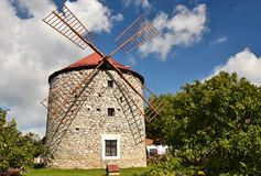 Beautiful old windmill and landscape with the sun. Ostrov u Macochy, Czech Republic. Europe. Royalty Free Stock Images