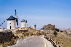 Beautiful and old windmills painted in white stock photos