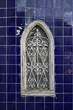 Beautiful old window of cemetery in tile background royalty free stock photography