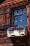 Beautiful old window decorated with flowers Stock Photo