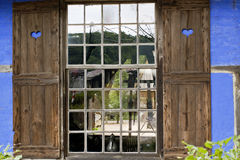 Beautiful old window with shutters Royalty Free Stock Photo