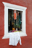 Beautiful old window with souvenirs Royalty Free Stock Image