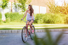 Beautiful old woman with bicycle in a park Royalty Free Stock Photos