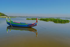 Beautiful old wooden boats. Near teak bridge U-BEIN. Mandalay Royalty Free Stock Photo