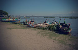 Beautiful old wooden boats. Near teak bridge U-BEIN. Mandalay Stock Photos