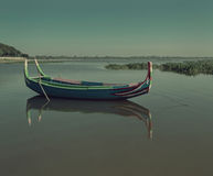 Beautiful old wooden boats. Near teak bridge U-BEIN. Mandalay Royalty Free Stock Photography