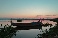 Beautiful old wooden boats. Near teak bridge U-BEIN. Mandalay Royalty Free Stock Photos