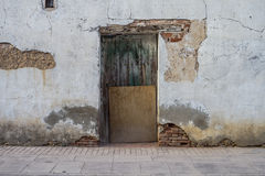 Beautiful old wooden door with old wall texture Stock Images