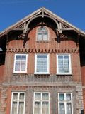 Old red wooden home, Lithuania Stock Photography