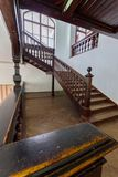Beautiful old wooden staircase with ornamental handrails leading to the upper floors of the house. For your design stock image