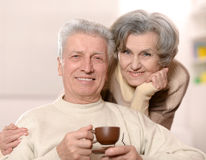 Beautiful older couple with coffee. Happy beautiful older couple with coffee cup Royalty Free Stock Photography