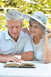 Beautiful older couple resting in the garden Stock Photography