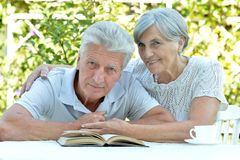 Beautiful older couple resting in the garden Stock Photo
