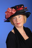 Beautiful older woman in black hat Royalty Free Stock Images