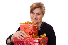 Beautiful older woman with a gift Royalty Free Stock Images