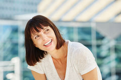 Beautiful older woman looking away laughing Stock Image