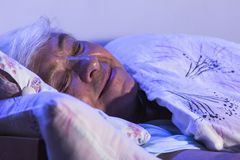 Beautiful older woman sleeping. In the bedroom Stock Images