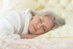 Beautiful older woman sleeping. In the bedroom royalty free stock image