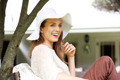 Beautiful older woman smiling with sun hat Stock Image